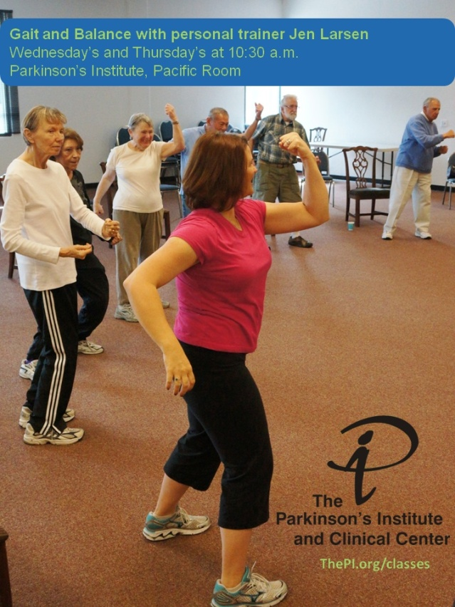 Woman in pink shirt leading workout with group of people at the Parkinson's Institute